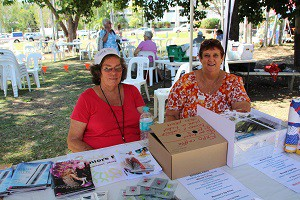 Chair of COTA Coomalie Jan Jewell helps with a raffle